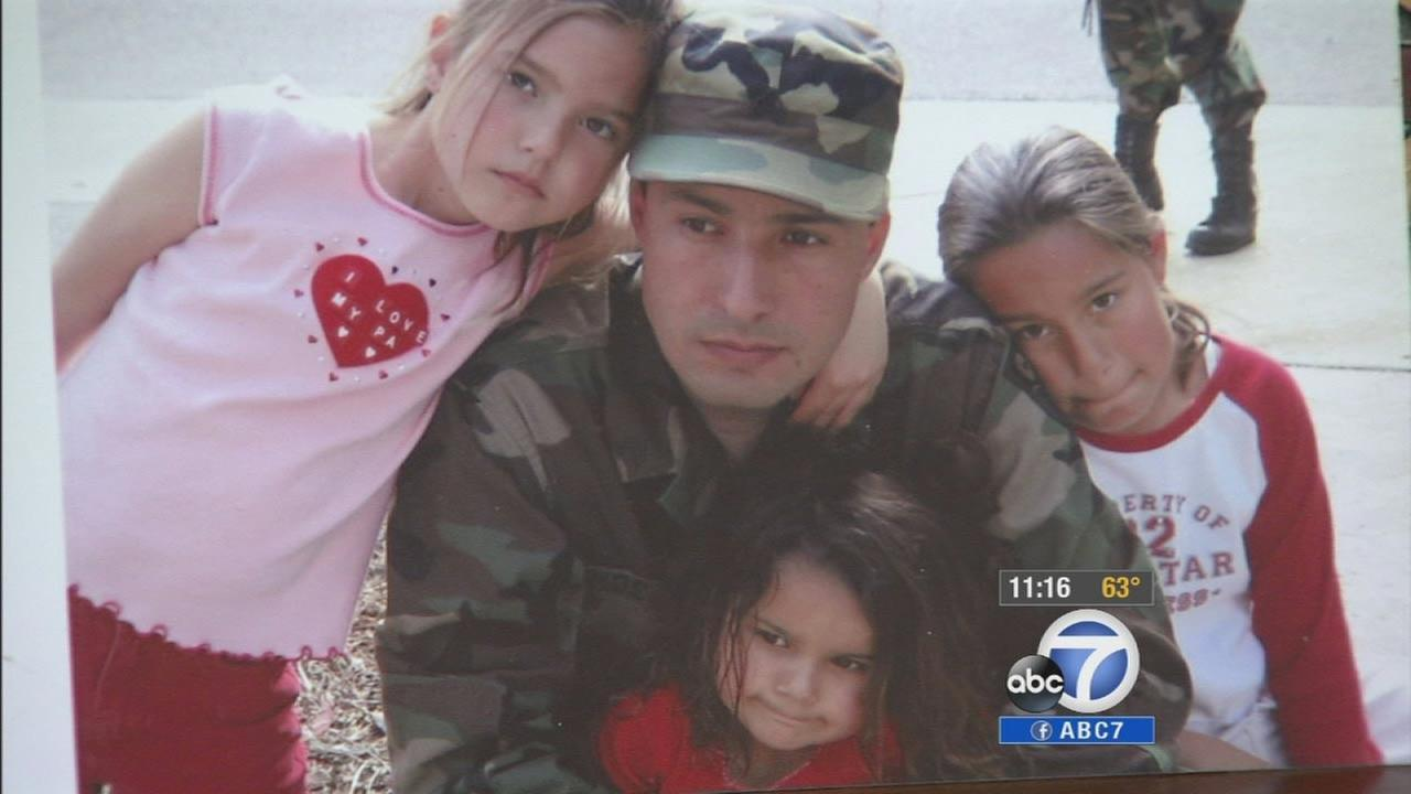 Master Sgt. Richard Mosely poses for a photo with his kids.