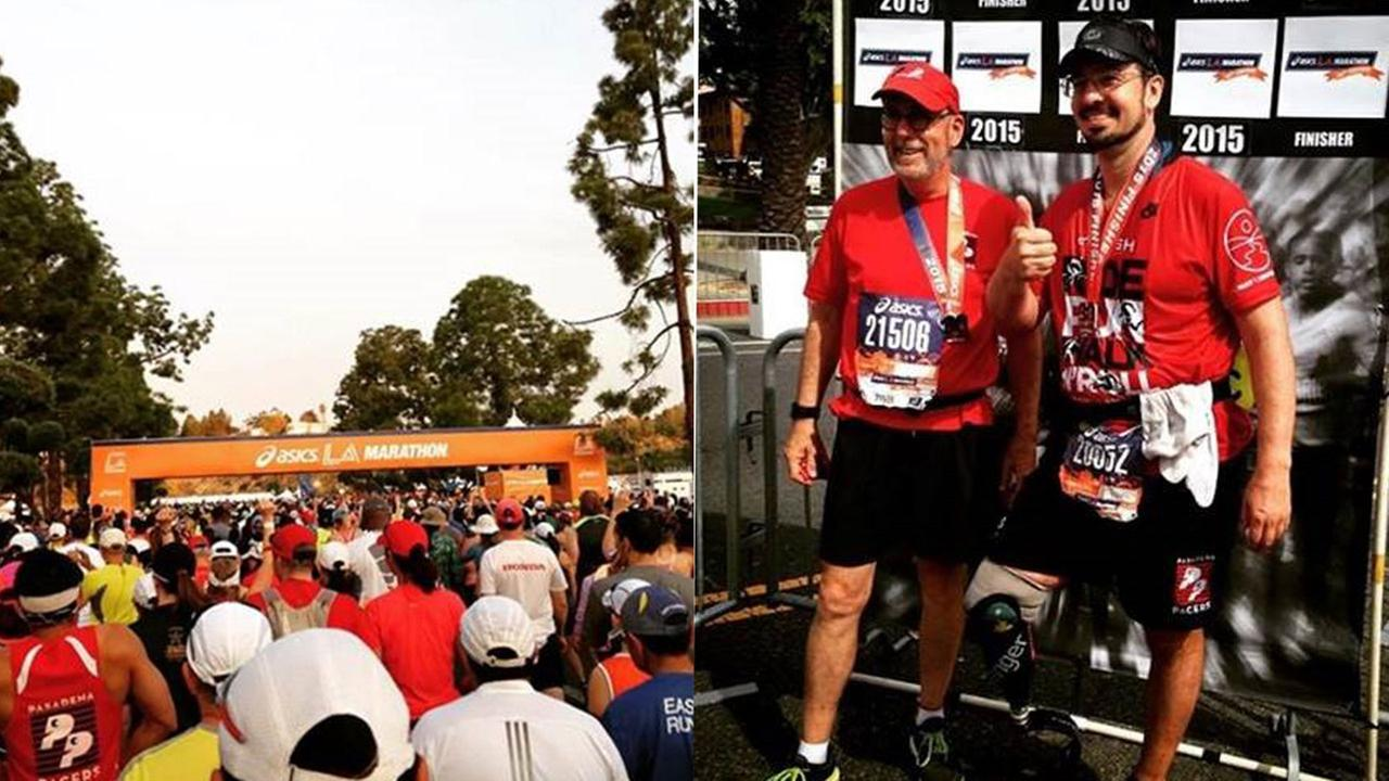 Damien Kevitt, right, finishes the LA Marathon in less than eight hours on Sunday, March 15, 2015.