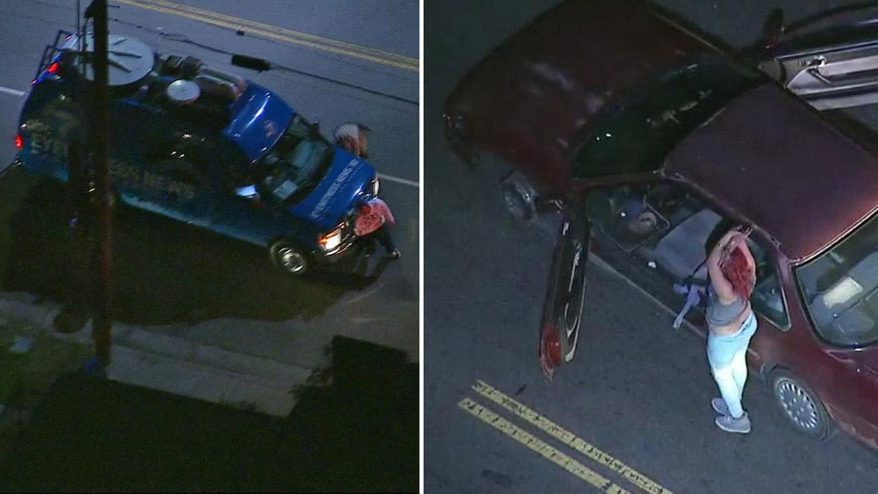 Two stolen car suspects were taken into custody near Main Street and 84th Place in South Los Angeles Tuesday, March 17, 2015.
