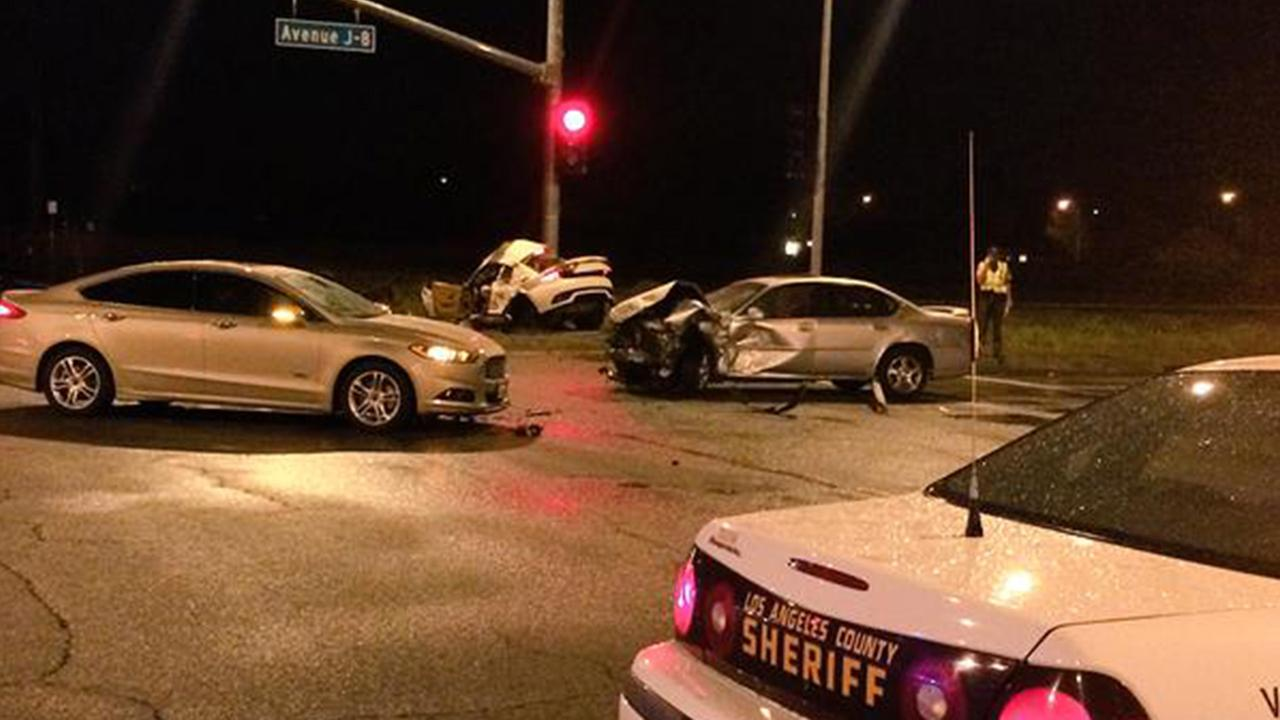 Los Angeles County sheriffs deputies investigate the scene of a crash that occurred during a thunderstorm in Lancaster, Wednesday, March 18, 2015.