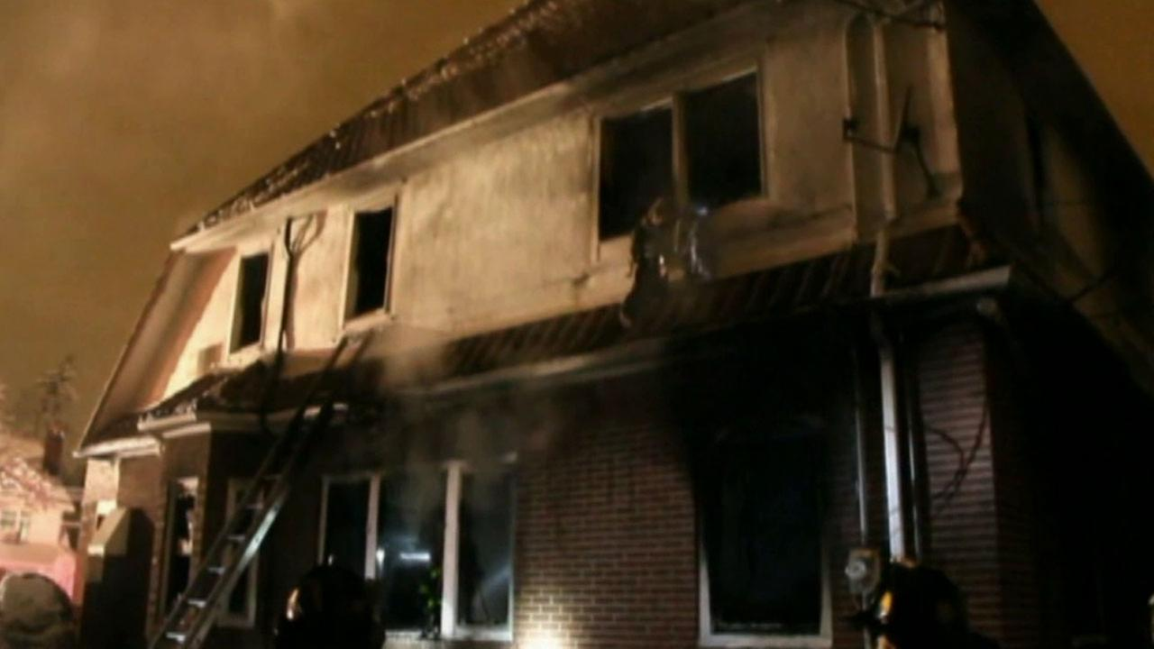 A fire raged through a house in the Brooklyn borough of New York, Saturday, March 21, 2015, killing seven children.