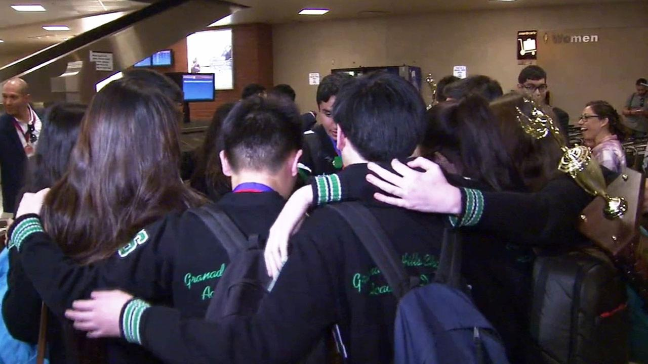 The Granada Hills Charter High Schools Academic Decathlon team huddles in a circle while celebrating their California Academic Decathlon win.