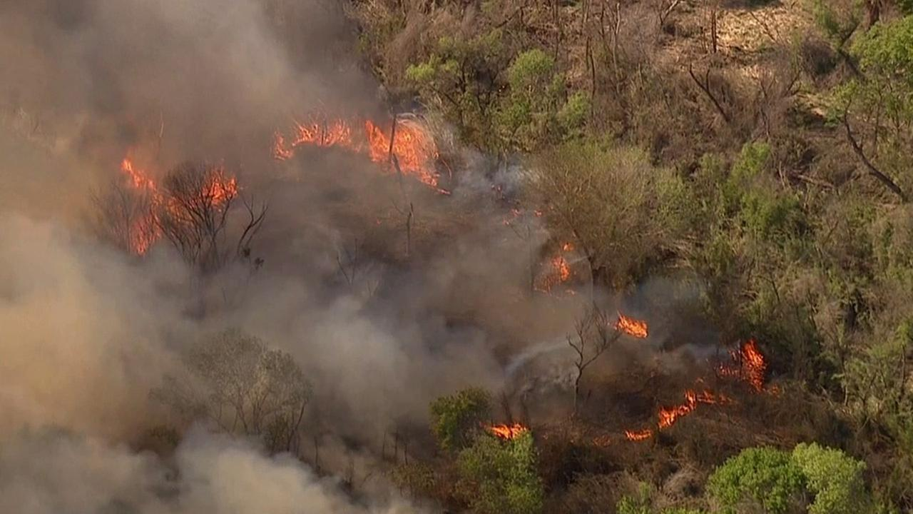 A one-acre brush fire broke out in the wash near Magic Mountain Parkway in Valencia on Monday, March 23, 2015.