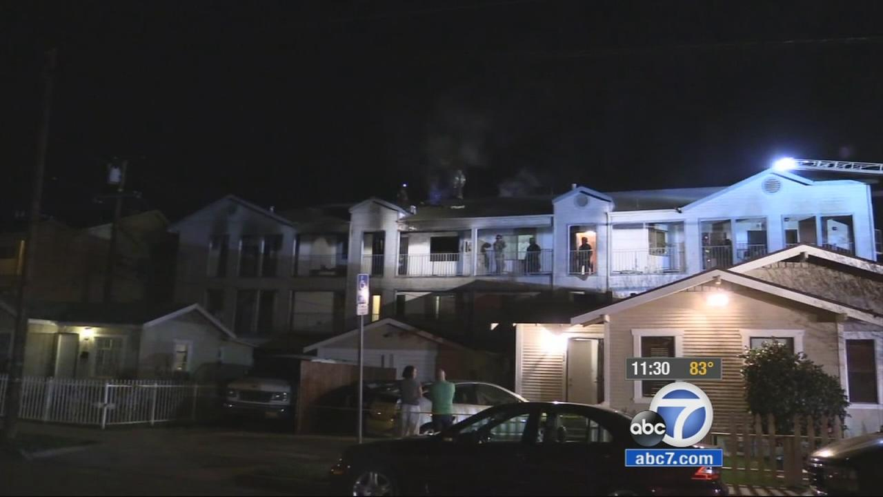 A 47-year-old mother and her 4-year-old daughter are in critical condition after their Long Beach apartment caught fire on Thursday, March 26, 2015.