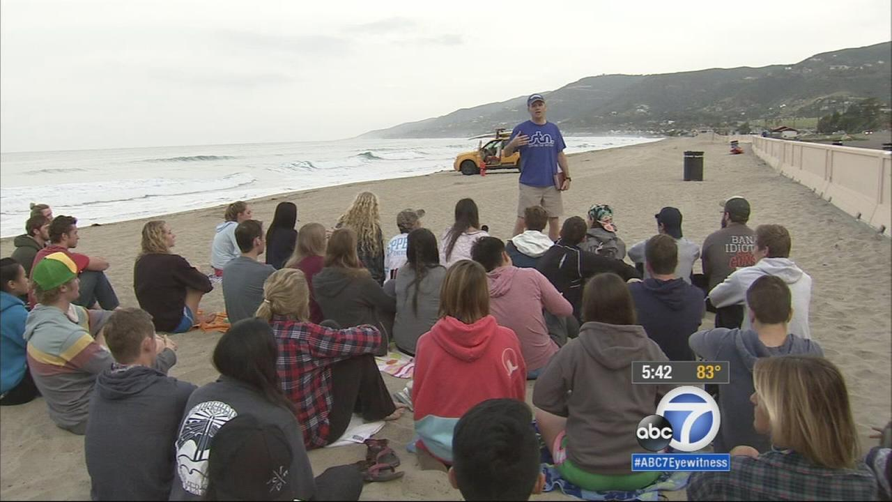 Pepperdine University assistant professor Rob Shearer offers students faith and fitness at a weekly convocation on the shores of Zuma Beach.