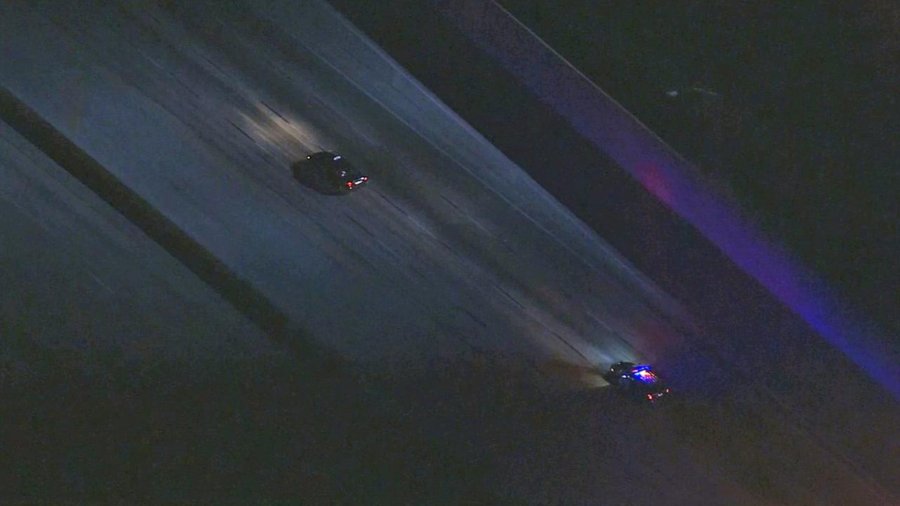 California Highway Patrol officers chase a stolen taxi suspect on the northbound 5 Freeway on Friday, March 27, 2015.