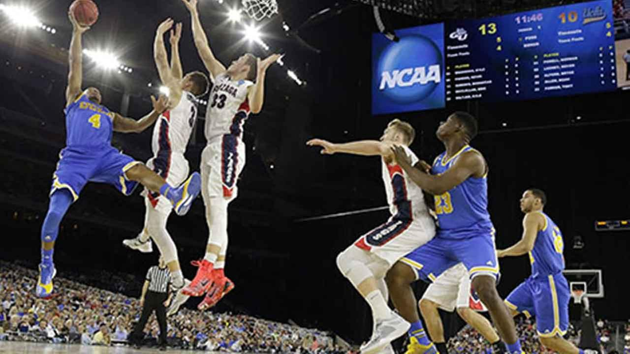 UCLAs Norman Powell (4) shoots against Gonzaga during the first half of a college basketball regional semifinal game in the NCAA Tournament Friday, March 27, 2015, in Houston.