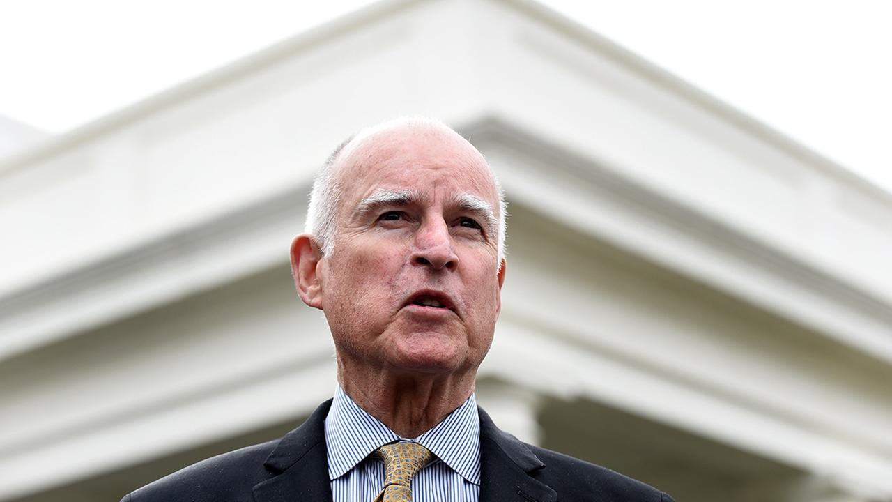 California Gov. Jerry Brown speaks to reporters outside the White House in Washington, Friday, March 13, 2015.