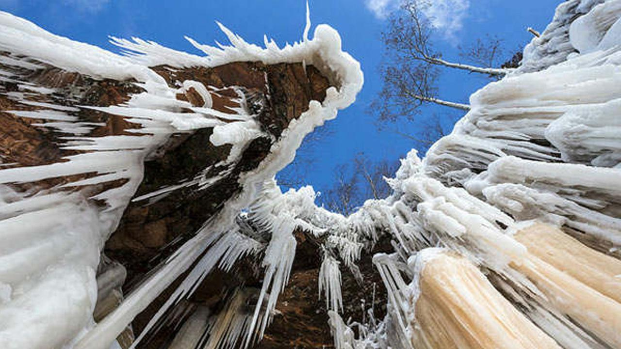 Lake Superior became so frozen in 2014 that visitors were able to walk to a dazzling display of icy terrain along the Apostle Islands National Lake.