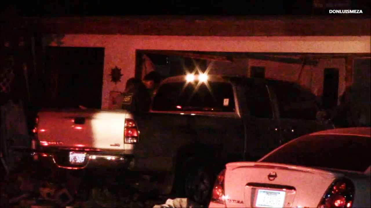 A truck slammed into a home in Lancaster, killing a female resident on Monday, March 30, 2015.