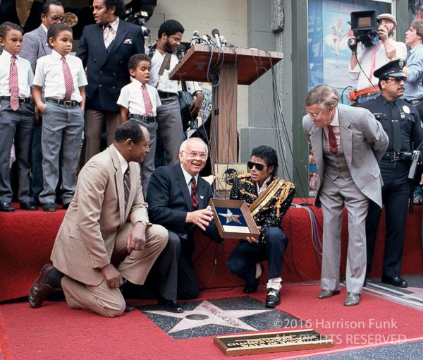 <div class='meta'><div class='origin-logo' data-origin='none'></div><span class='caption-text' data-credit='Harrison Funk/ALL RIGHTS RESERVED'>Michael Jackson receives a star on the Hollywood Walk of Fame on Nov. 20, 1984.</span></div>