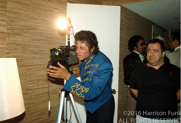 <div class='meta'><div class='origin-logo' data-origin='none'></div><span class='caption-text' data-credit='Harrison Funk/ALL RIGHTS RESERVED'>Michael Jackson operates a video camera.</span></div>