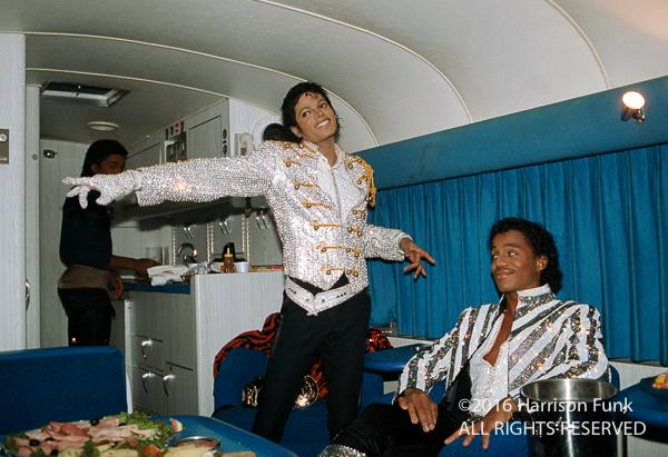 <div class='meta'><div class='origin-logo' data-origin='none'></div><span class='caption-text' data-credit='Harrison Funk/ALL RIGHTS RESERVED'>During a rain delay on the Victory Tour stop in Philadelphia, Michael Jackson shows his brother Marlon Jackson how he's going to snap his fingers, point, and stop the rain.</span></div>