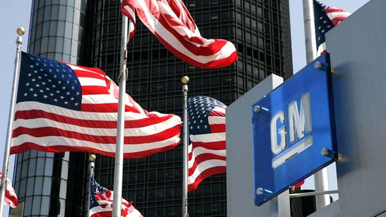 U.S. flags are shown outside of General Motors world headquarters in a Detroit file photo from April 18, 2006.