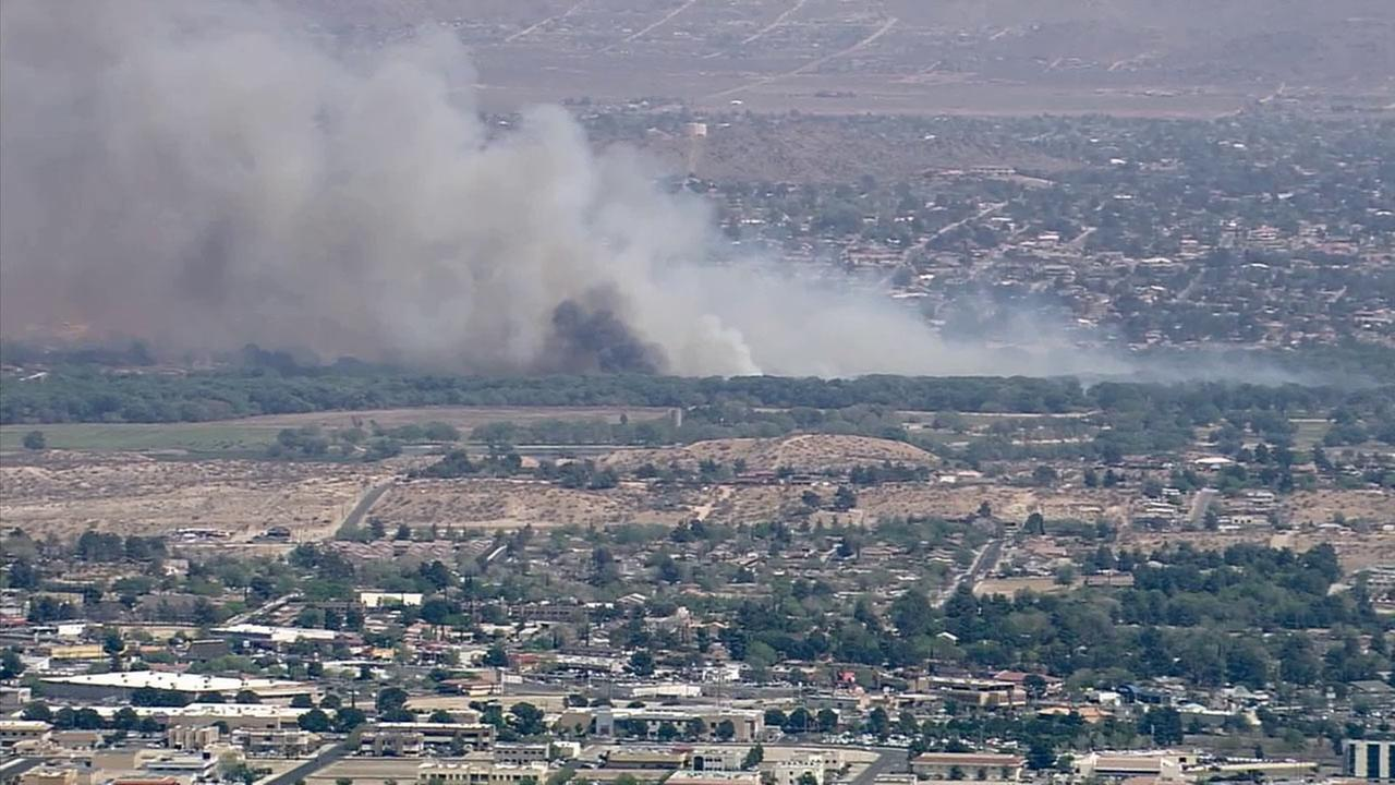 A brush fire burns in the Apple Valley area on Tuesday, March 31, 2015.