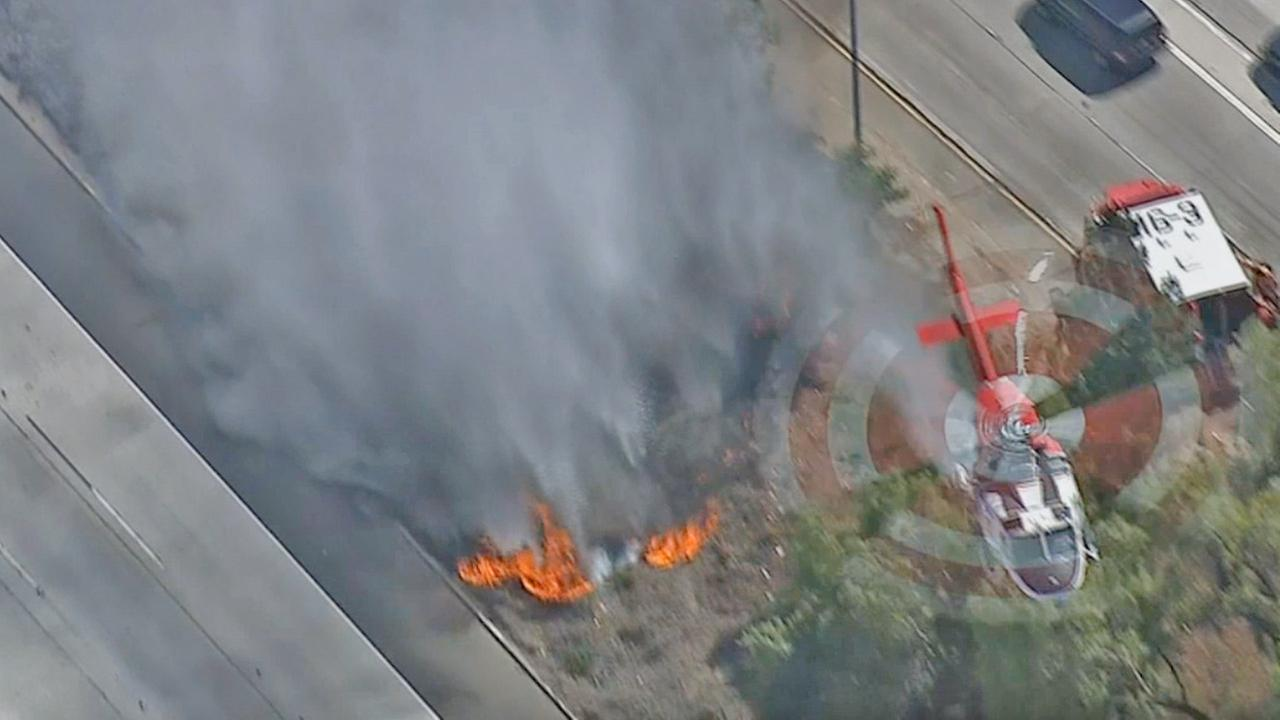 A brush fire burned alongside the 405 Freeway near the 118 Freeway in Granada Hills on Wednesday, May 14, 2014.