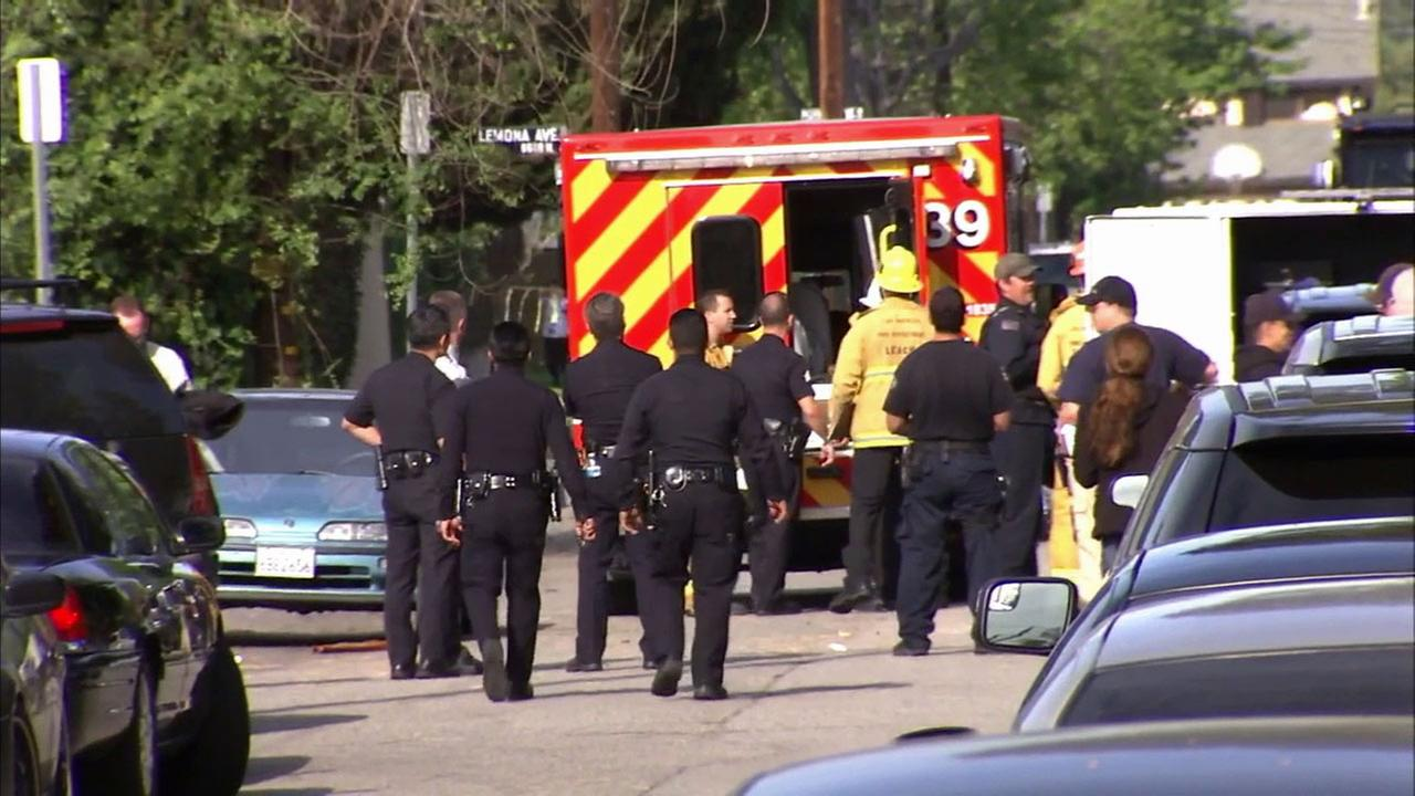 A suspect is treated by paramedics at the end of a Van Nuys standoff on Wednesday, April 1, 2015.