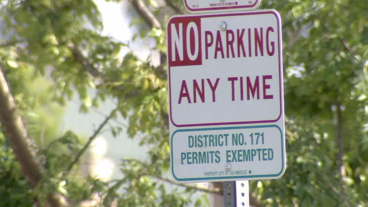 A parking restriction sign is shown in this undated file photo.