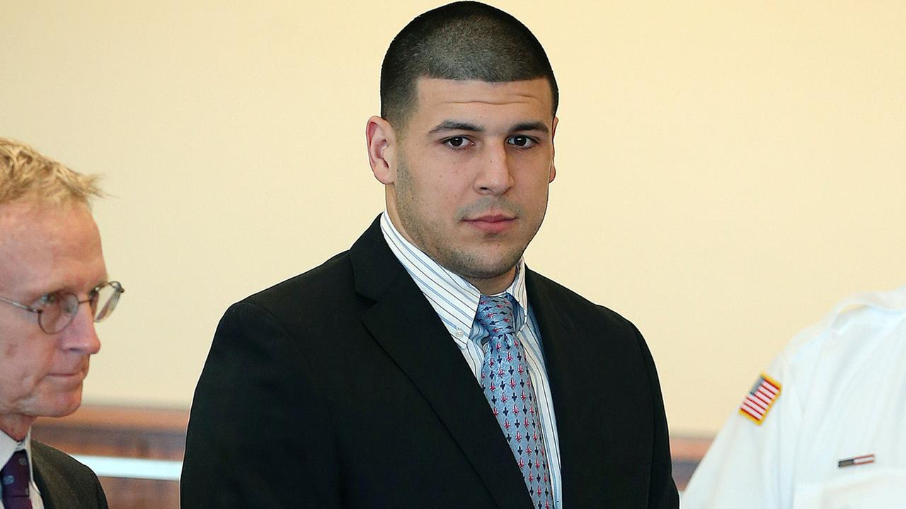 Former New England Patriots football player Aaron Hernandez stands during a hearing at Bristol Superior Court on Friday, Feb. 7, 2014, in Fall River, Mass.