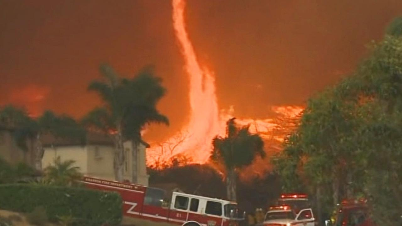 A structure burns in one of several wildfires in San Diego, Thursday, May 15, 2014.