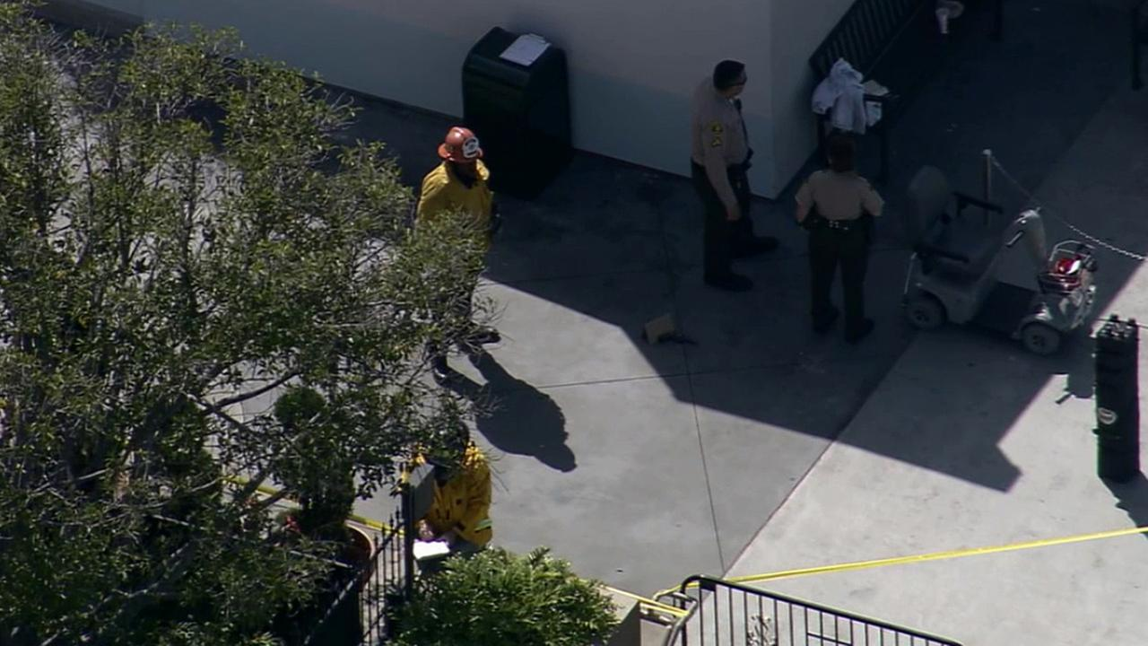 Los Angeles County sheriffs deputies and firefighters respond to a reported self-inflicted shooting of a man at Universal Studios Hollywood on Friday, April 3, 2015.
