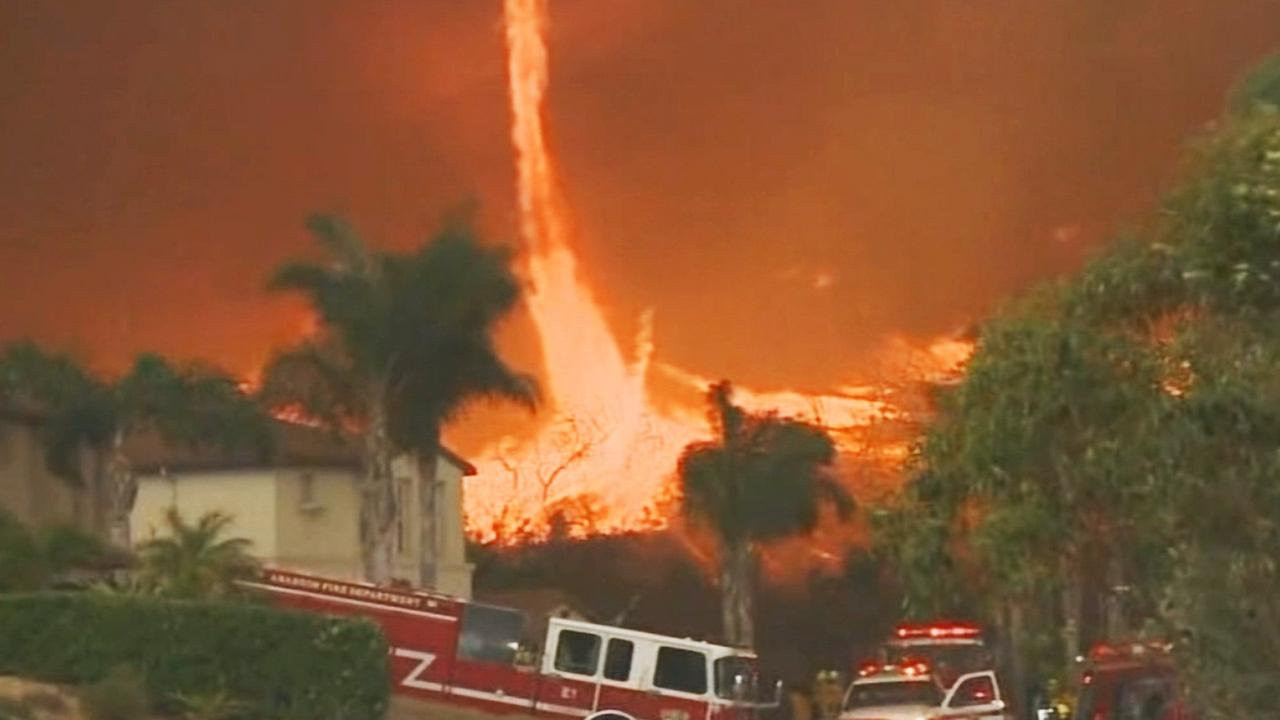 A firenado burns above houses in San Diego County on Thursday, May 15, 2014.