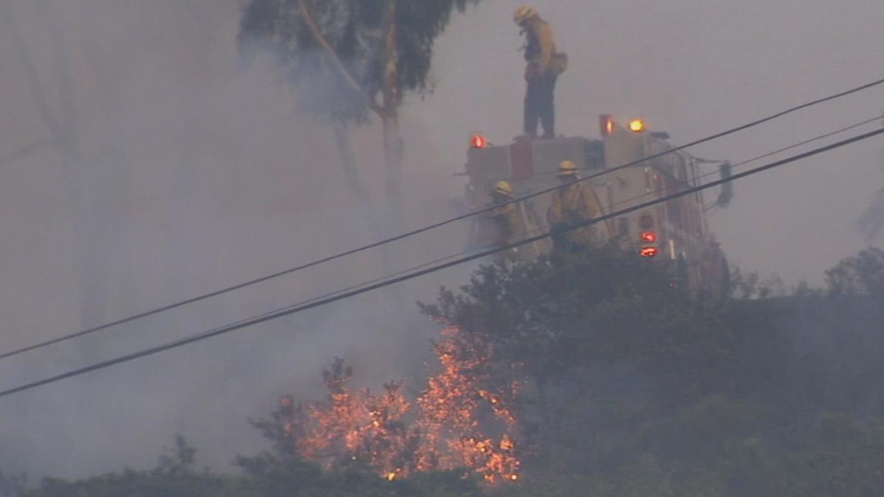 Firefighters work on a fire in San Diego County on Thursday, May 15, 2014.