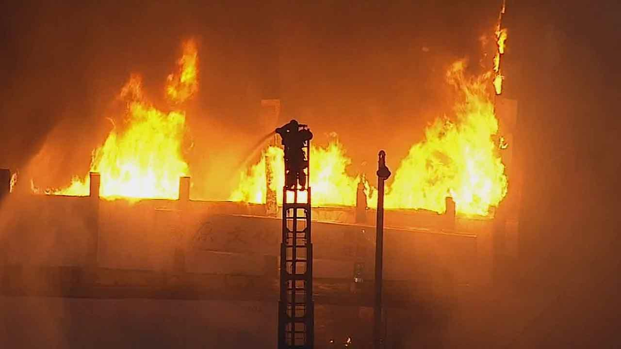 San Gabriel firefighters used ladder-mounted hoses to pour water on a commercial building fire on the 200 block of South San Gabriel Boulevard Thursday, May 15, 2014.