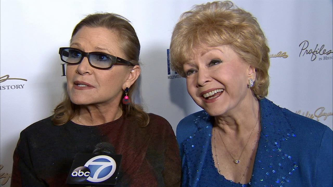 Carrie Fisher and her mother, actress Debbie Reynolds, at the Debbie Reynolds: The Auction Finale preview in North Hollywood on Wednesday, May 14, 2014.