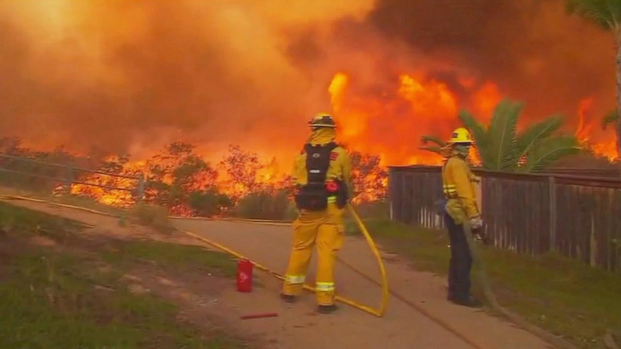 Firefighters attack flames in San Diego County on Friday, May 16, 2014.