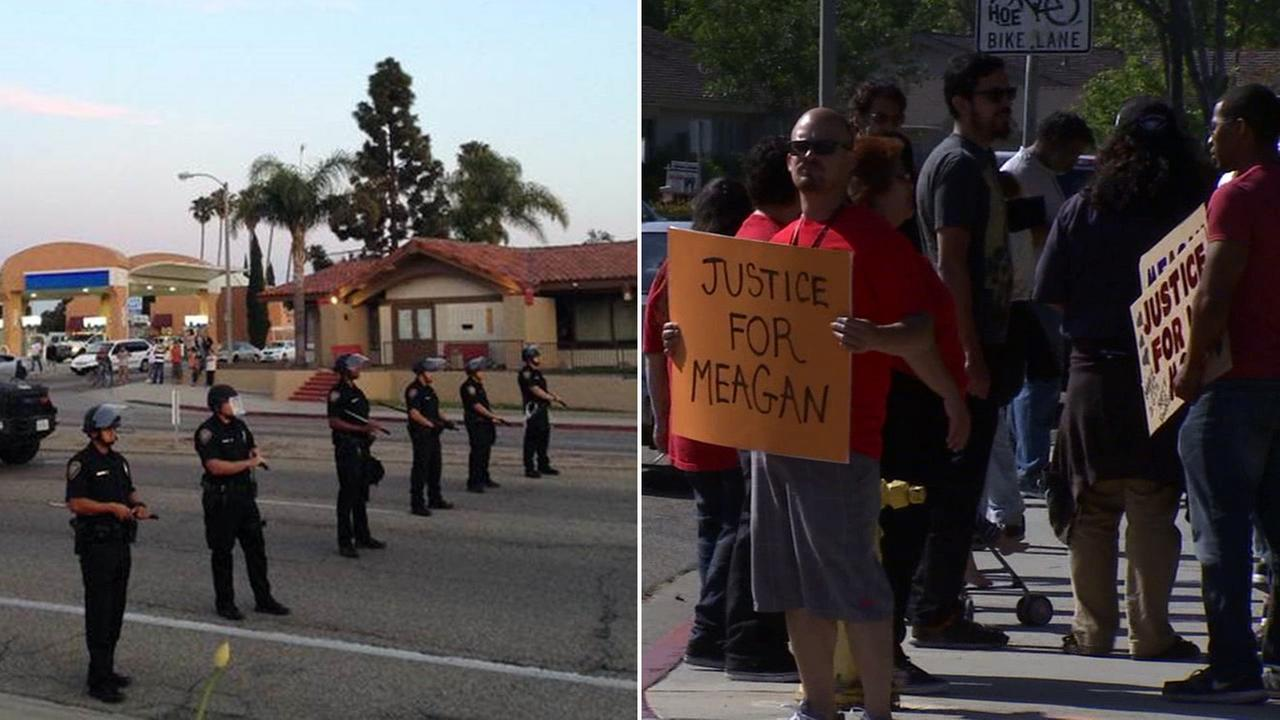Oxnard police break up a march for a woman fatally shot by an Oxnard police officer. A protester holds a sign that reads, Justice for Meagan, during a march on April 11, 2015.