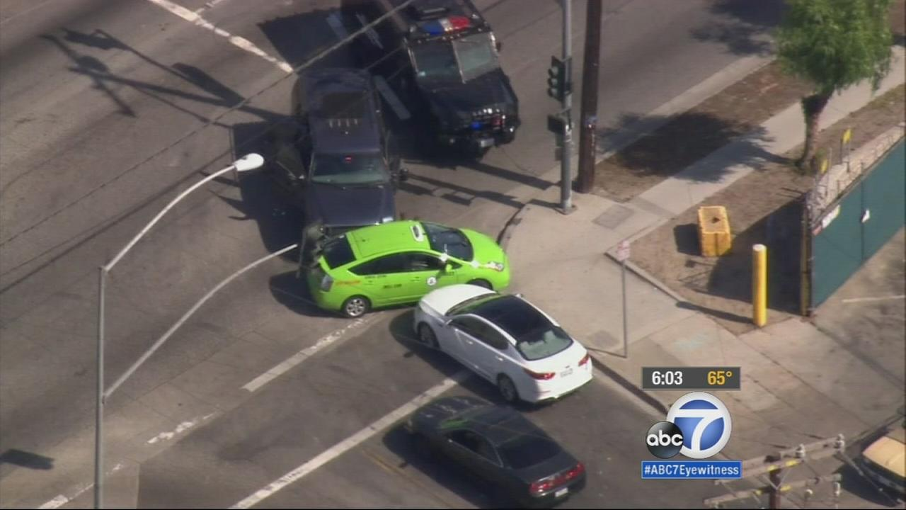 An allegedly stolen taxi on the run is stopped by armored vehicles driven by LAPD on Friday, April 10, 2015.