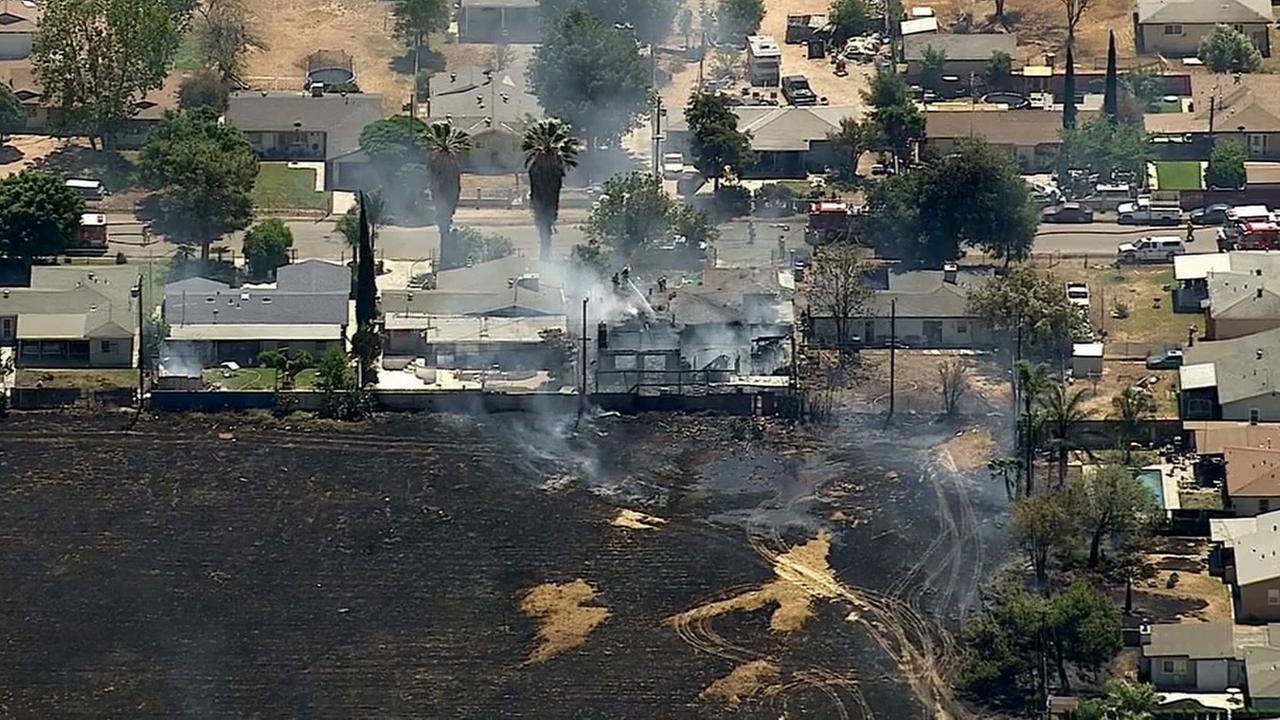 An 8-acre vegetation fire broke out near near Van Buren and 60th Street in Jurupa Valley Thursday, April 16, 2015.