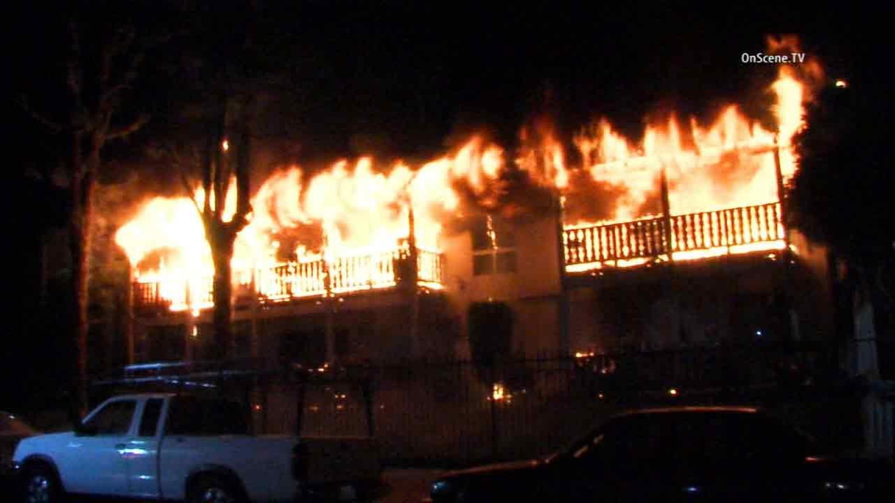 An apartment building is engulfed in flames in the 9000 block of Cedros Avenue in Panorama City on Thursday, April 16, 2015.