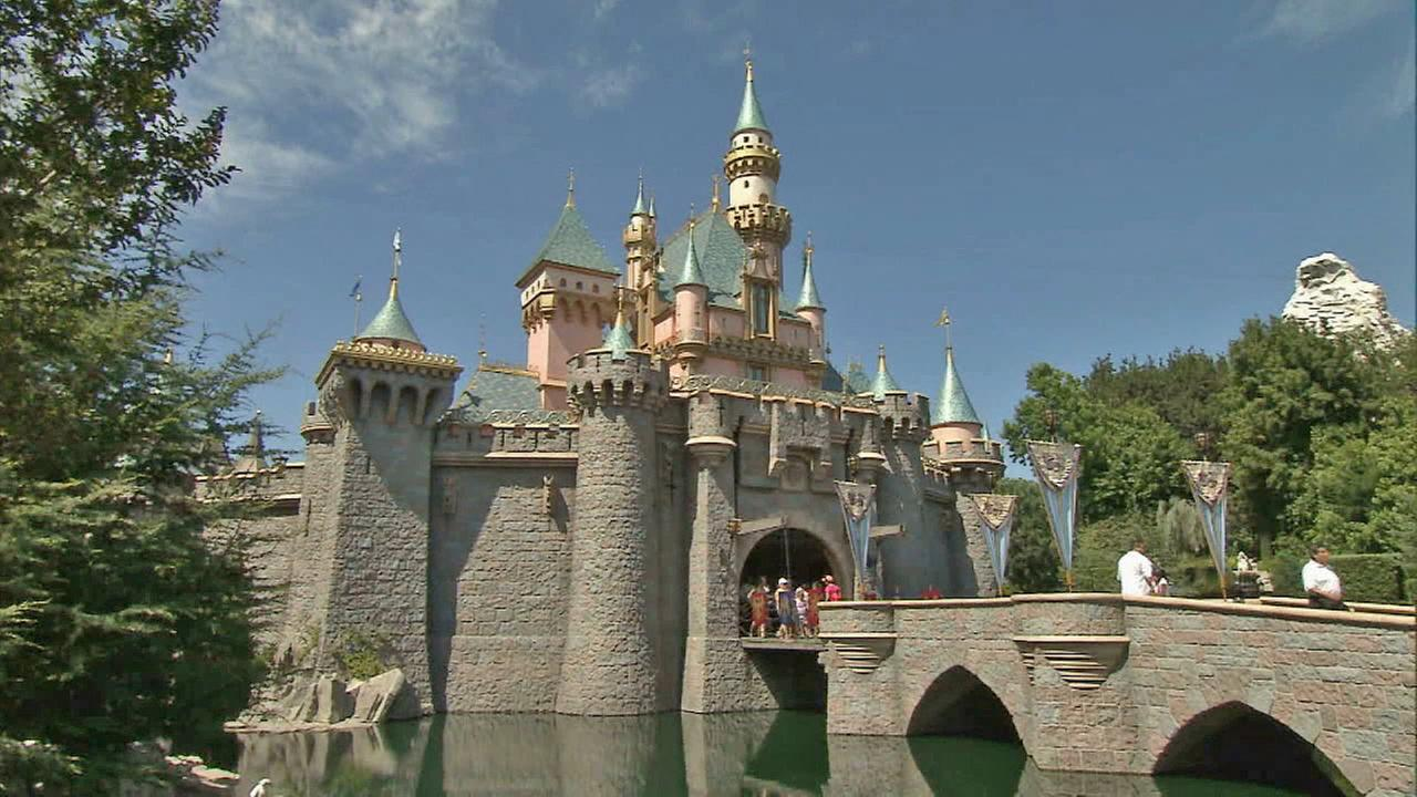 People are seen outside Sleeping Beauty Castle at Disneyland in this undated file photo.