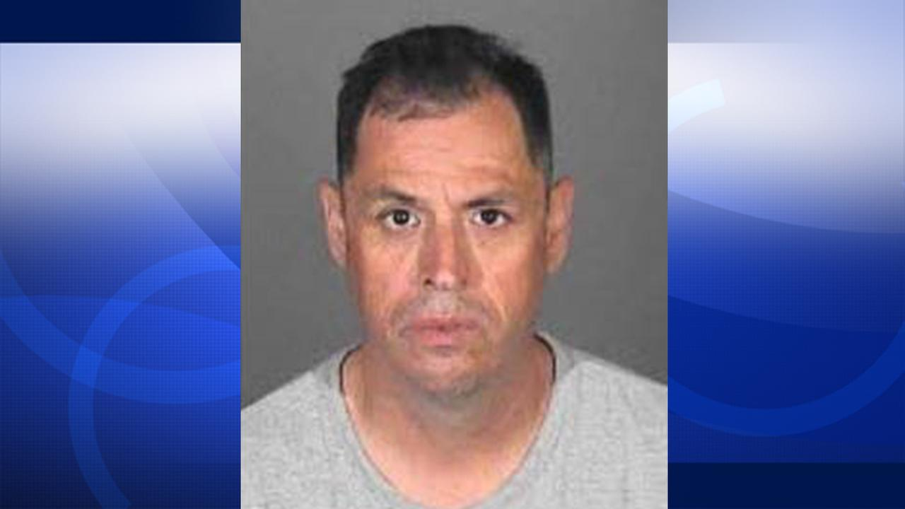 Jaime Jimenez is shown in his booking photo.