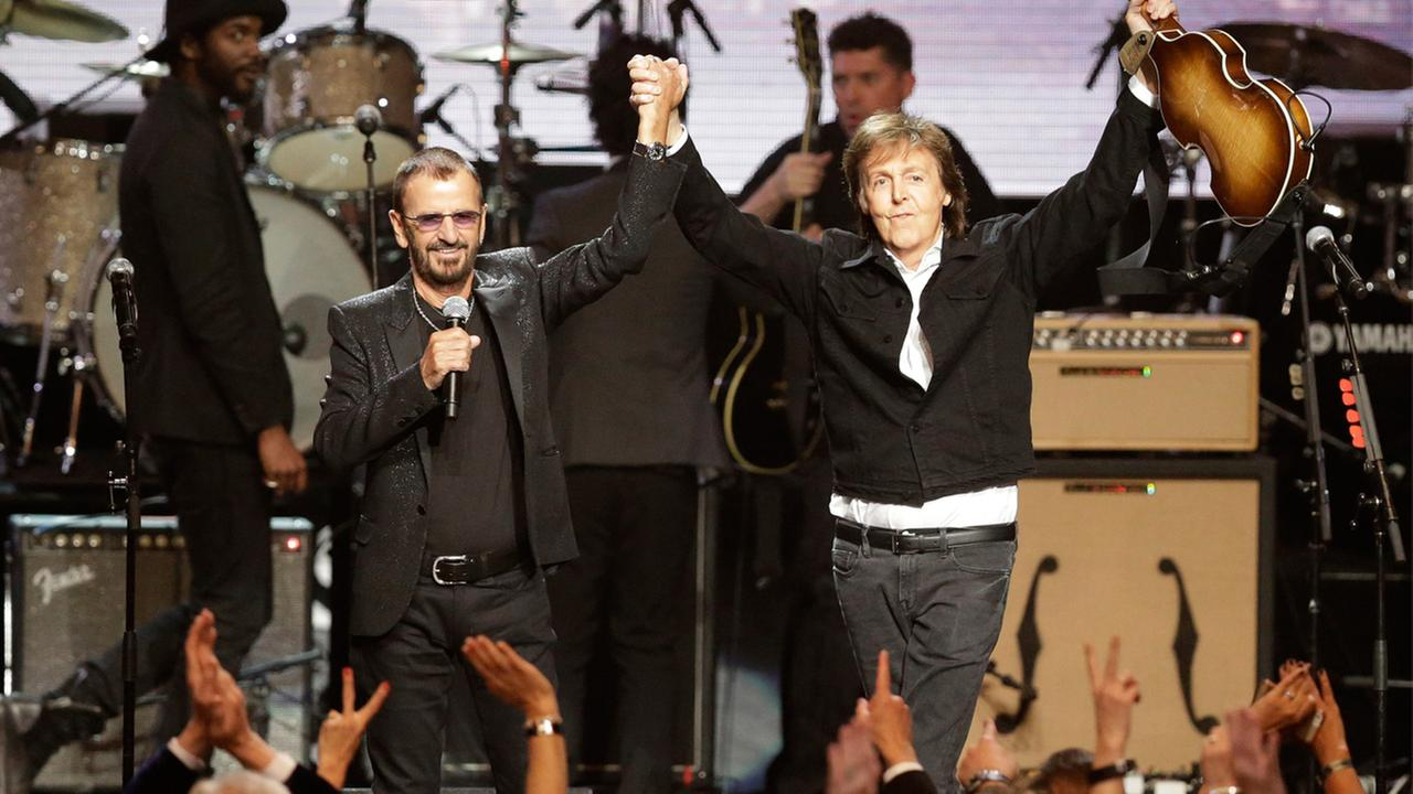 Ringo Starr, left, and Paul McCartney acknowledge the crowd at the Rock and Roll Hall of Fame Induction Ceremony Sunday, April 19, 2015, in Cleveland.
