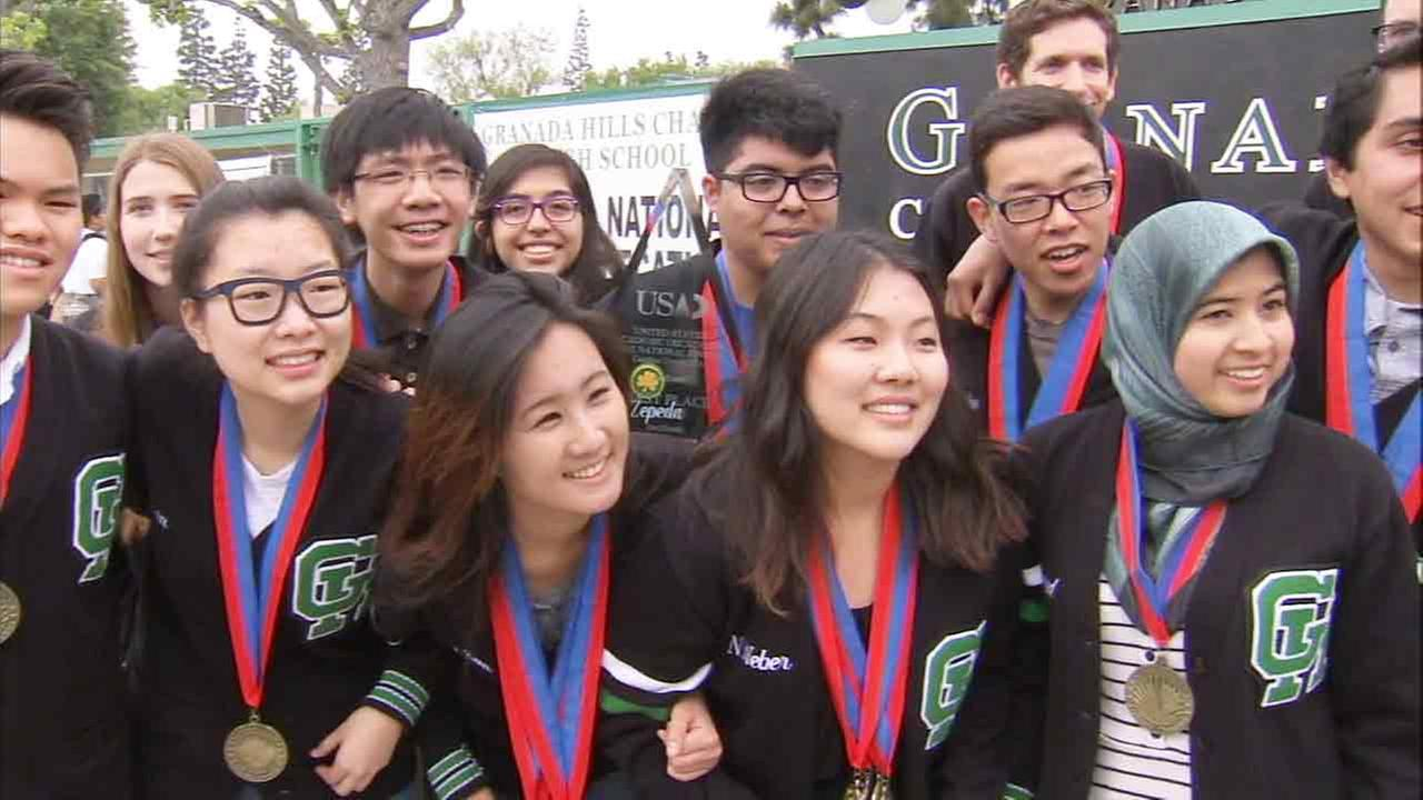 The Granada Hills Charter High School decathlon team pose for a photo following their victory in the National 2015 Academic Decathlon.