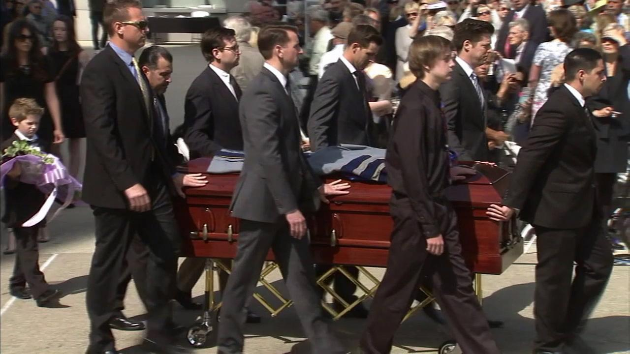 Pallbearers carry the casket of Rev. Robert H. Schuller during a public memorial service for Schuller at the Christ Cathedral, Monday, April 20, 2015, in Garden Grove.