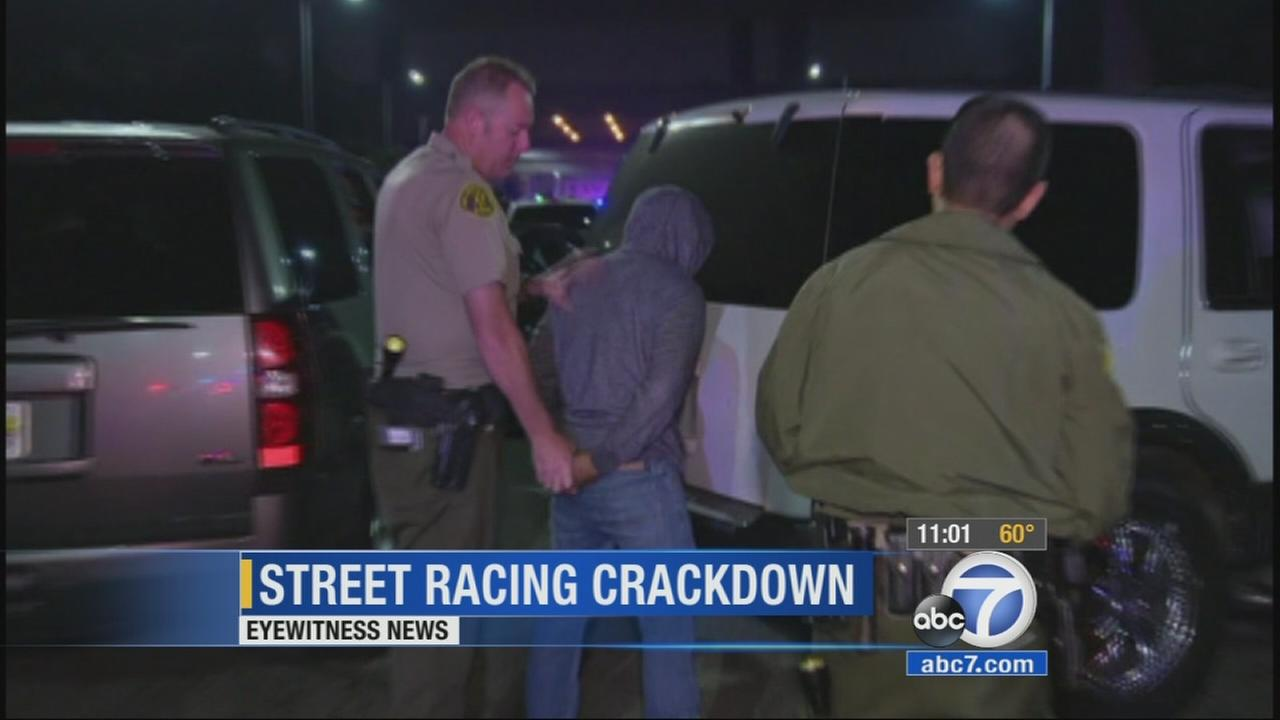 Los Angeles County sheriffs deputies and California Highway Patrol officers arrested dozens in a crackdown on street racing in South Los Angeles Monday, April 20, 2015.