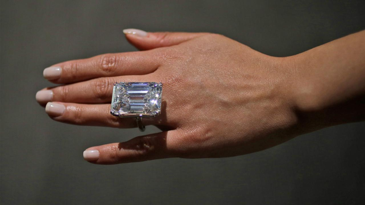 A Sothebys employee models a 100-carat emerald-cut diamond, Friday, April 17, 2015, in New York.