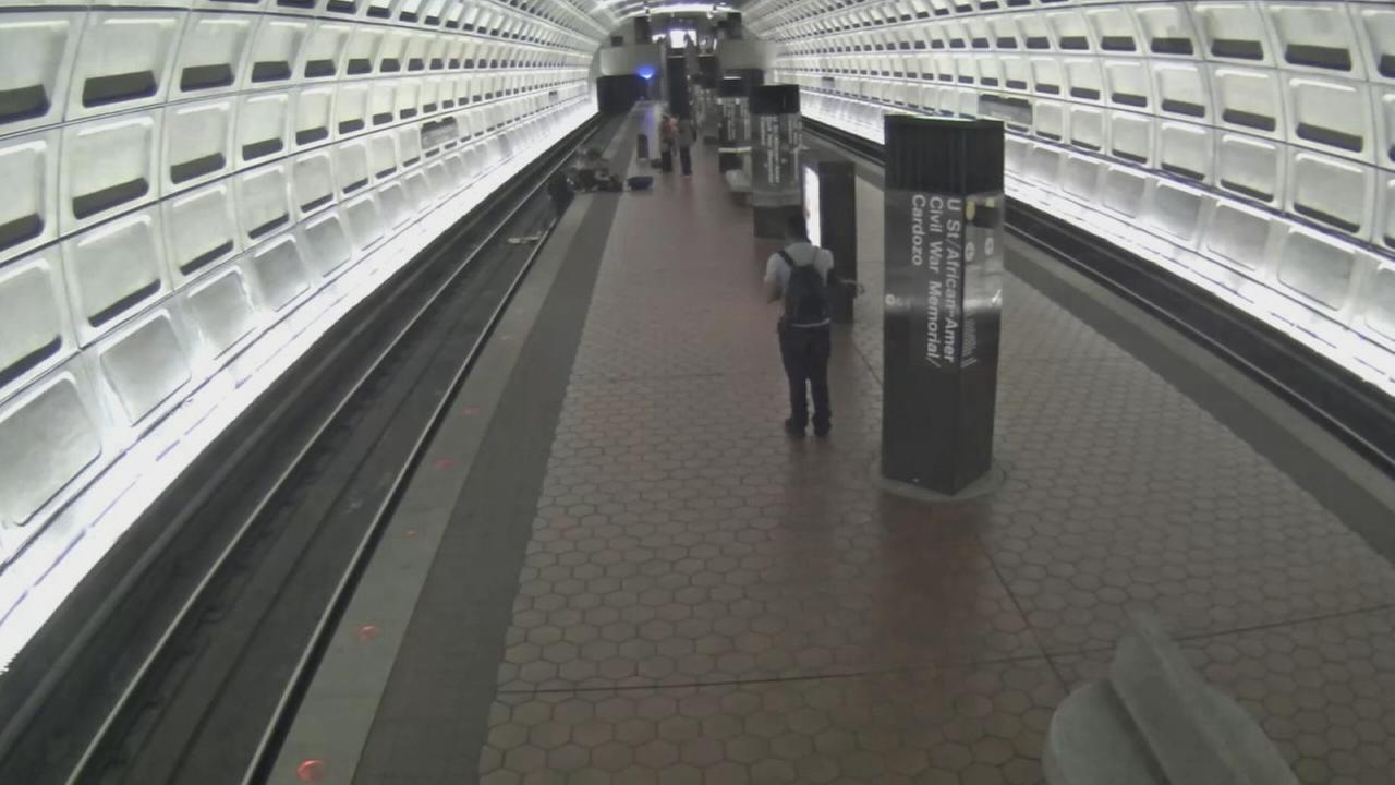 A man in a wheelchair fell from the platform onto the tracks at a Washington, D.C. Metro station, and video shows several people rushing to his aid.