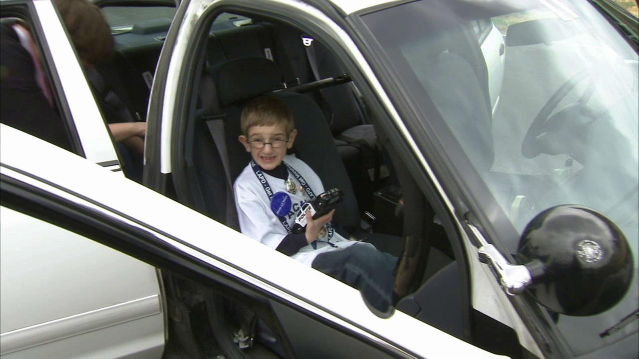 Cohen got to ride in a Los Angeles police cruiser.
