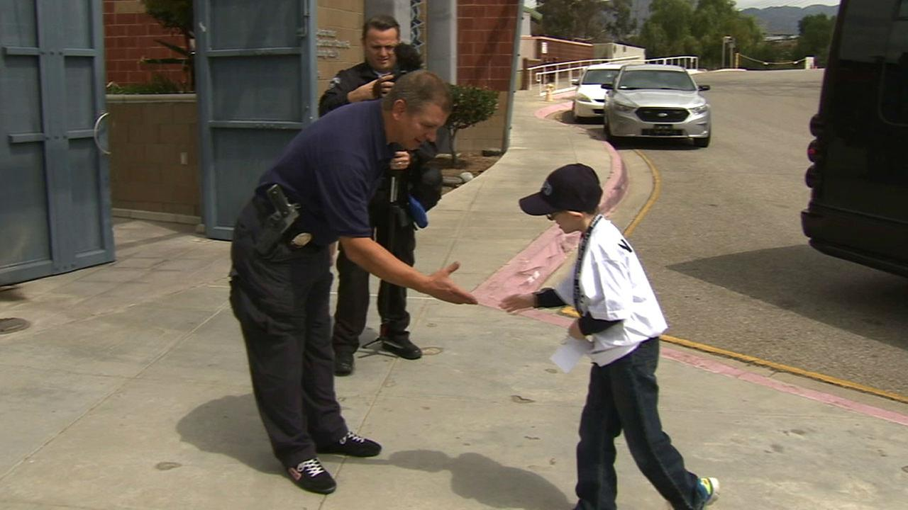 Noah Cohen, 8, hung out with the Los Angeles Police Department as part of his wish on Thursday, April 23, 2015.
