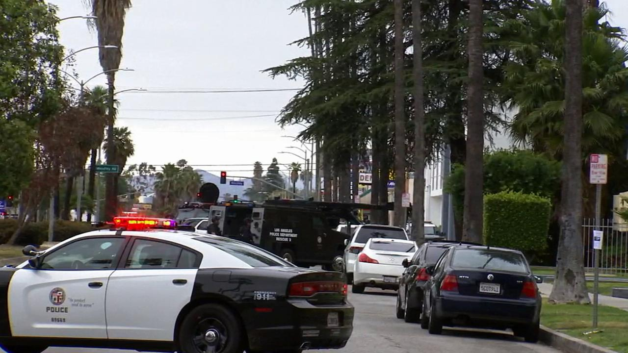 Los Angeles police respond to a call about an alleged gunman in 15900 block of Sherman Way in Van Nuys on Friday, April 24, 2015.