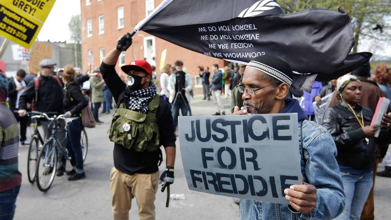 Protestors gather outside the Baltimore Police Departments Western District police station before a match for Freddie Gray, Saturday, April 25, 2015, in Baltimore.
