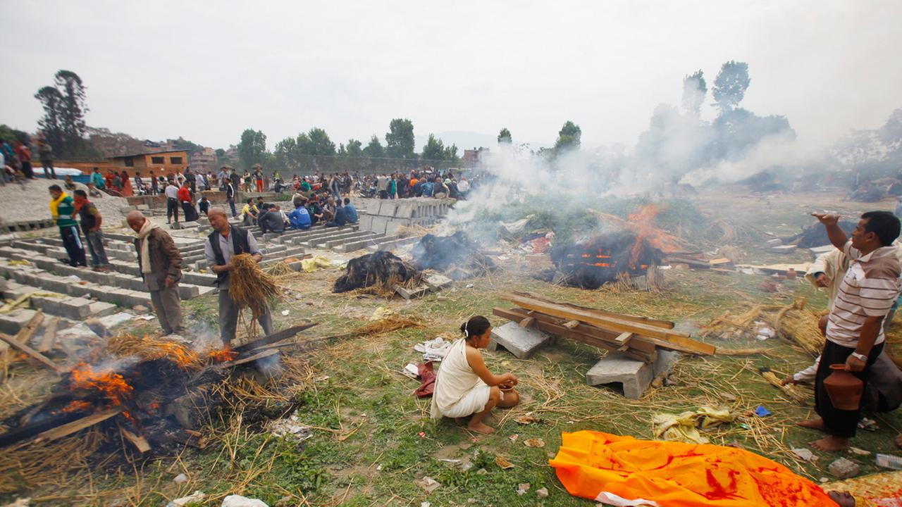 Nepalese people gather to cremate family members who fell victim to Saturdays earthquake, in Bhaktapur, Nepal, Sunday, April 26, 2015.