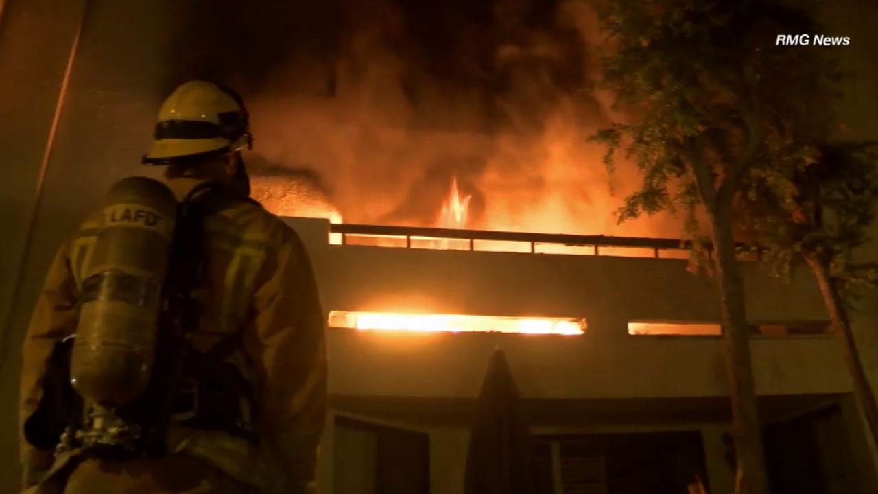 Los Angeles firefighters knocked down a fire at a four-story building near Burbank Boulevard and Owensmouth Avenue in Woodland Hills Saturday, April 25, 2015.