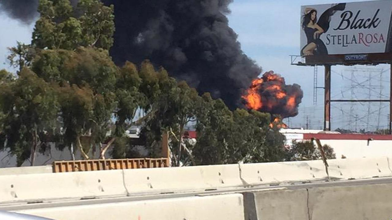 Flames are visible on the 710 Freeway after a tanker overturns and erupts in flames on Sunday, April 26, 2015.