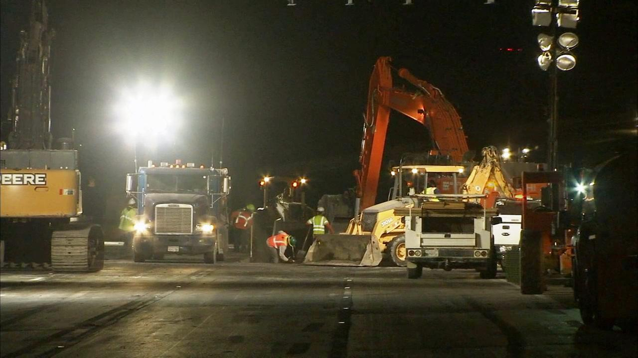 Crews repair the roadways after a tanker truck exploded on the 710 Freeway in the city of Bell on Sunday, April 26, 2015.
